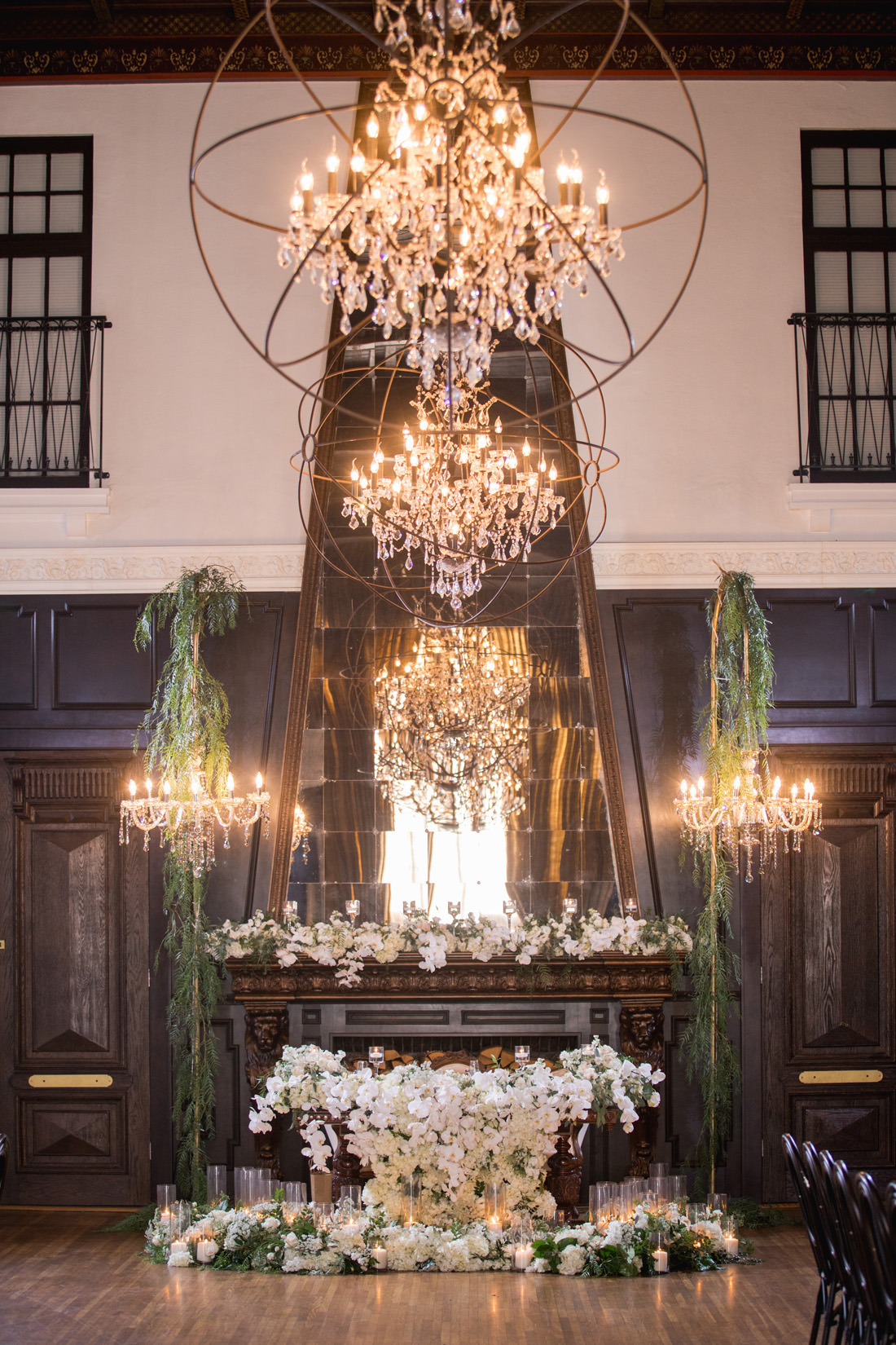 extravagant sweetheart table wedding decoration ideas chandeliers greenery fireplace