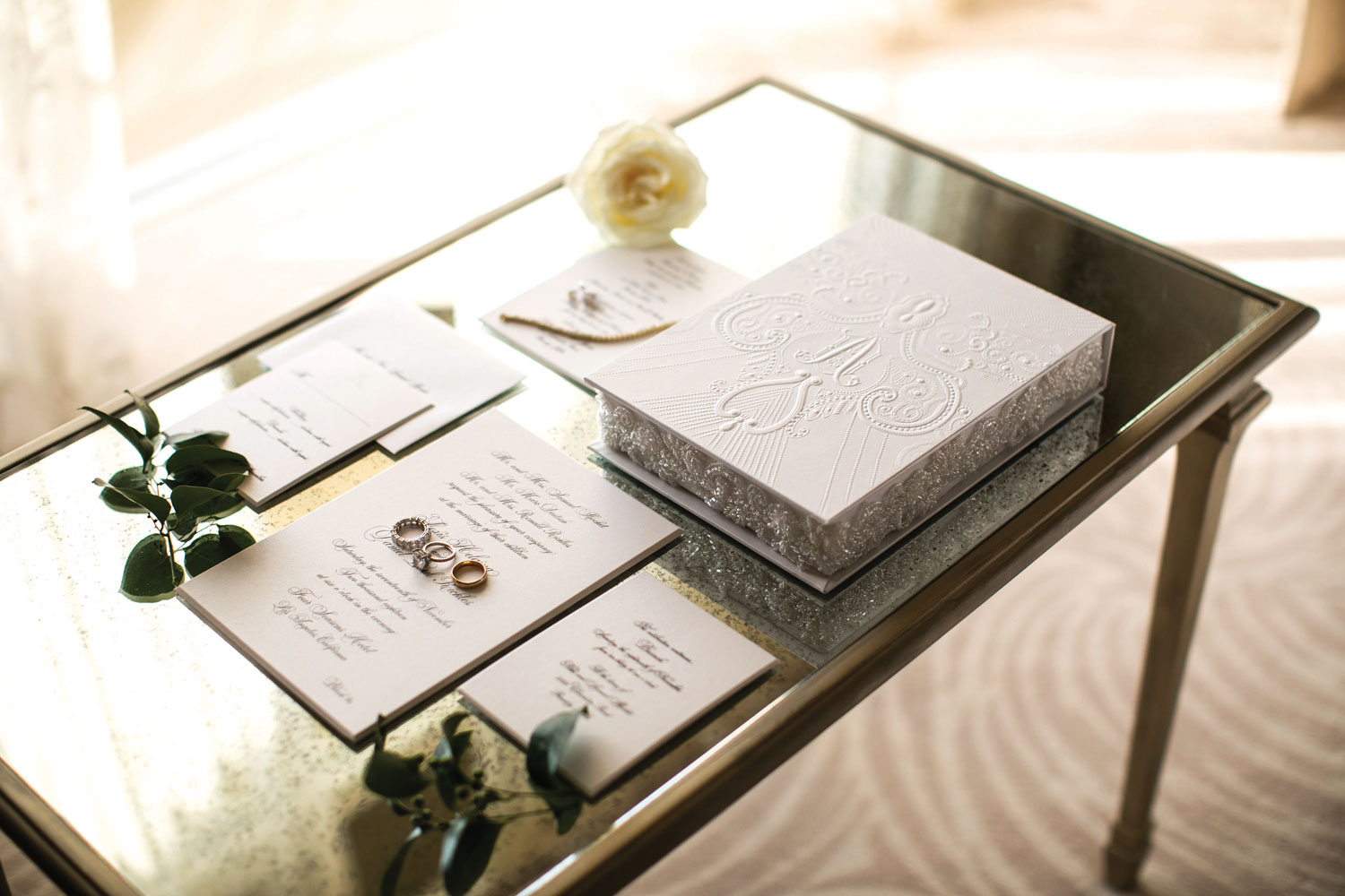 Inside Weddings magazine winter 2020 issue preview wedding invitation by lehr and black on table with flowers