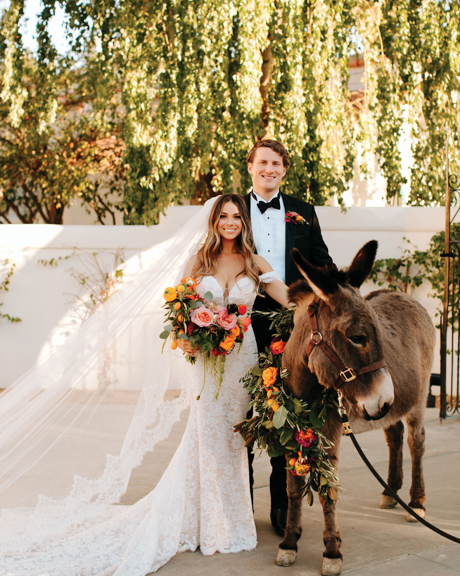 Inside Weddings magazine winter 2020 issue preview bride and groom with donkey at la quinta resort and club