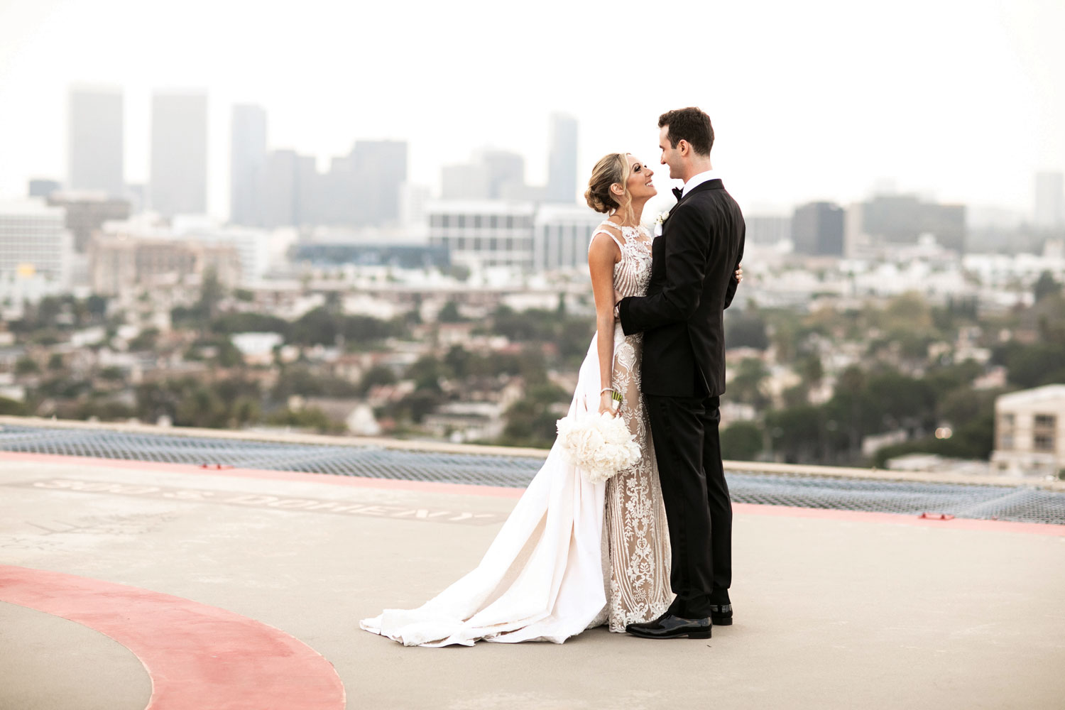 Inside Weddings magazine winter 2020 issue preview bride and groom on rooftop los angeles dear maradee bridal stylist
