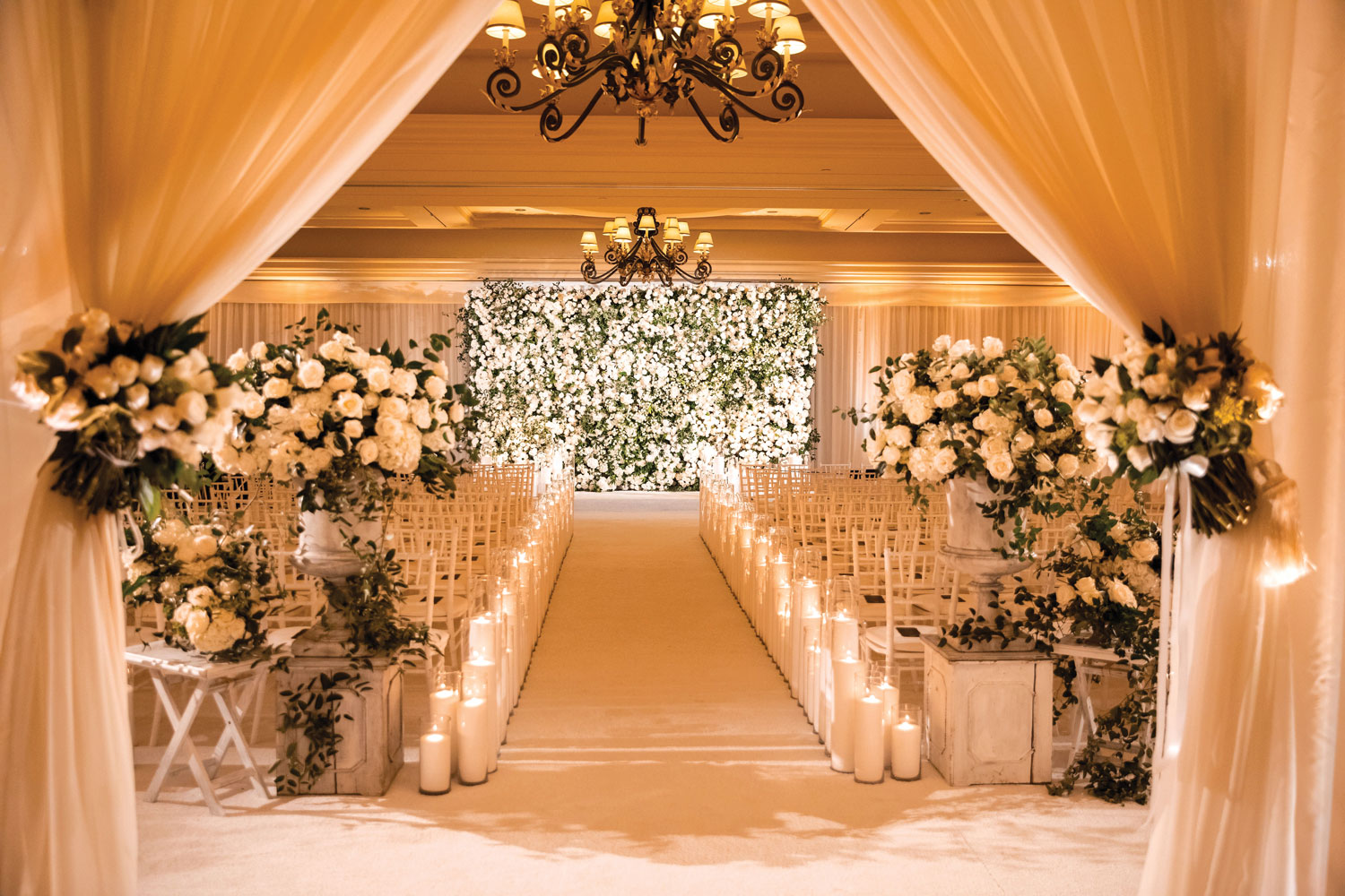 Inside Weddings magazine winter 2020 issue preview ballroom wedding ceremony flower wall