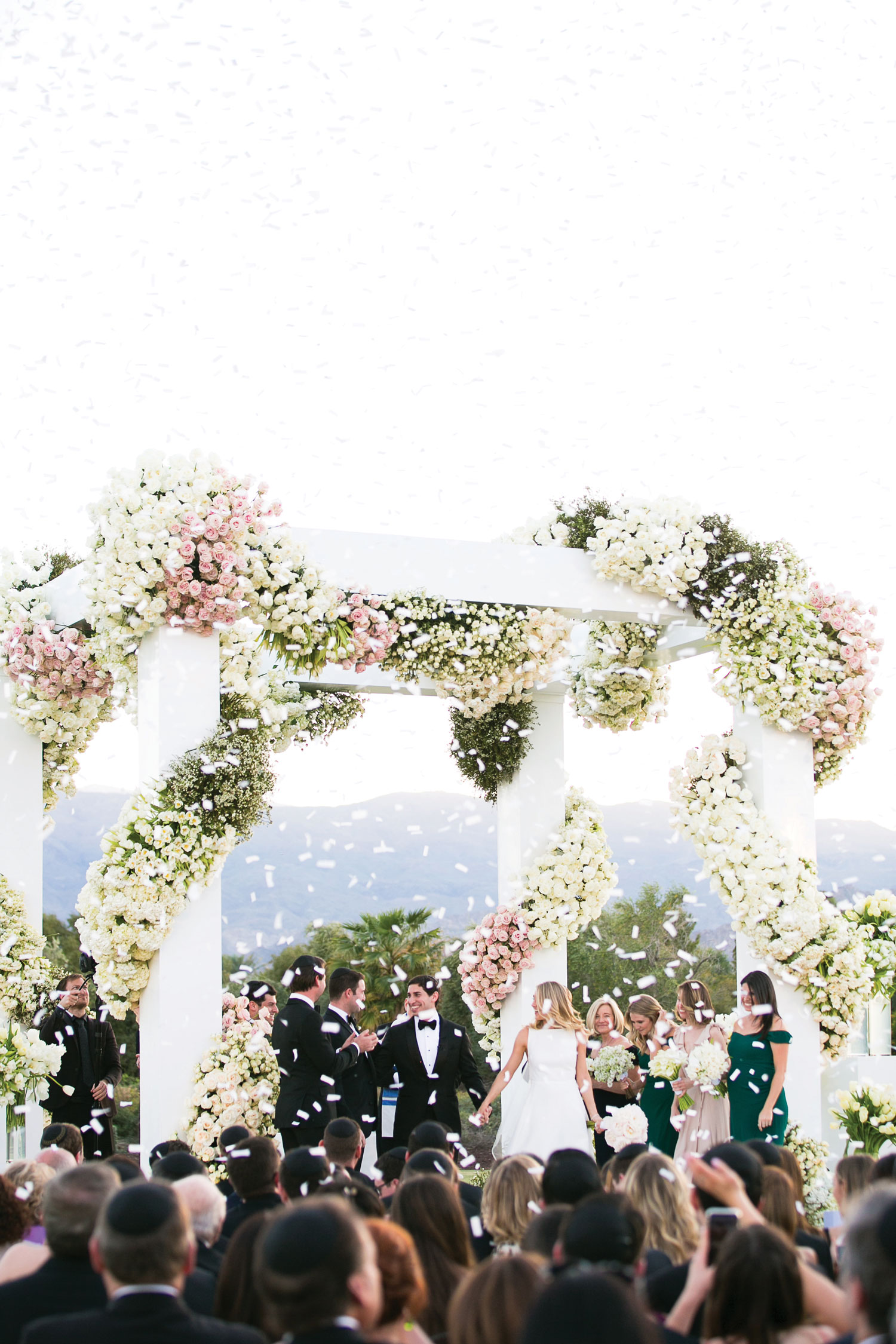 Inside Weddings magazine winter 2020 issue preview confetti at outdoor wedding ceremony luxury