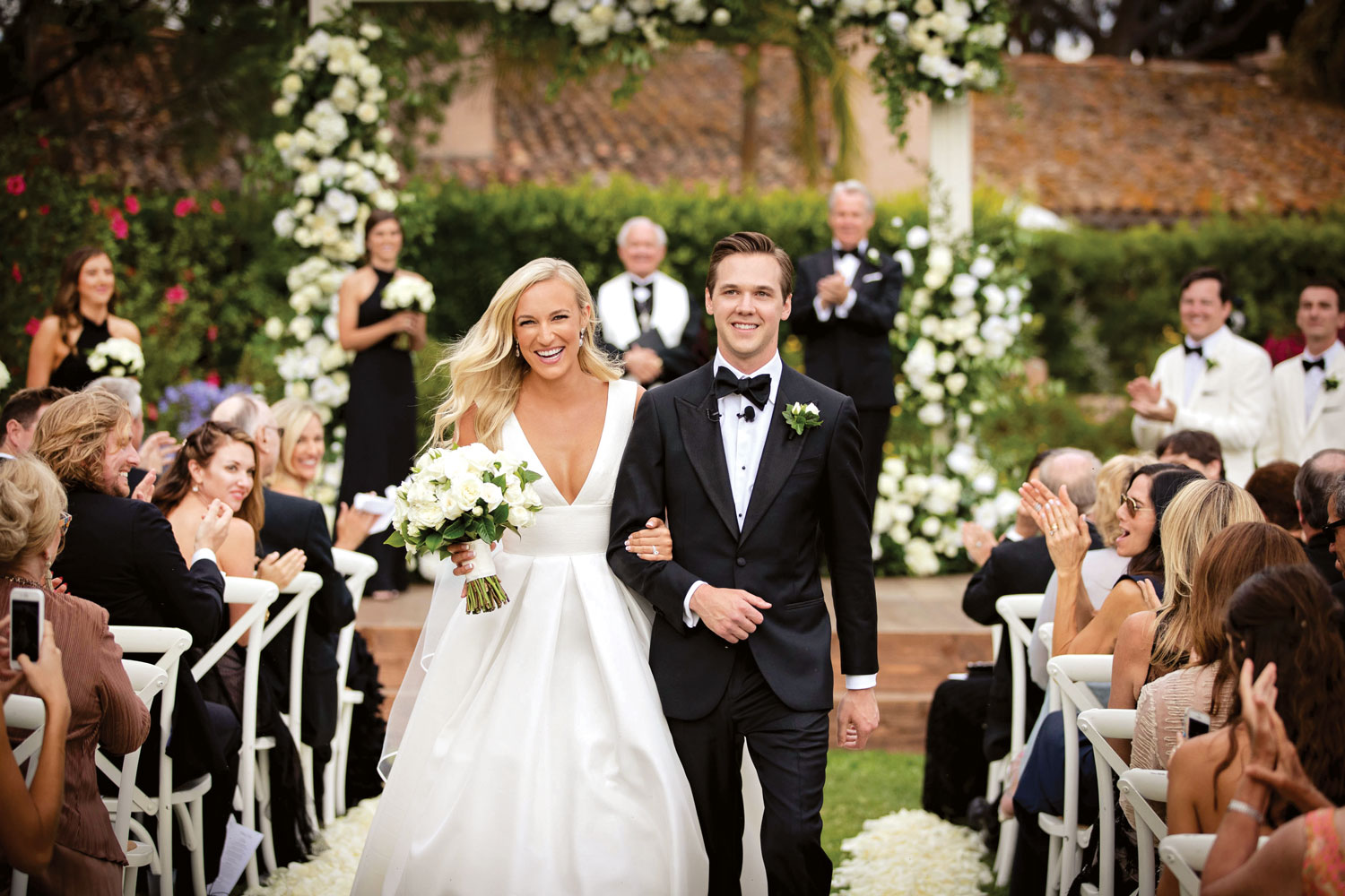 Inside Weddings magazine winter 2020 issue preview happy bride and groom outdoor wedding ceremony recessional