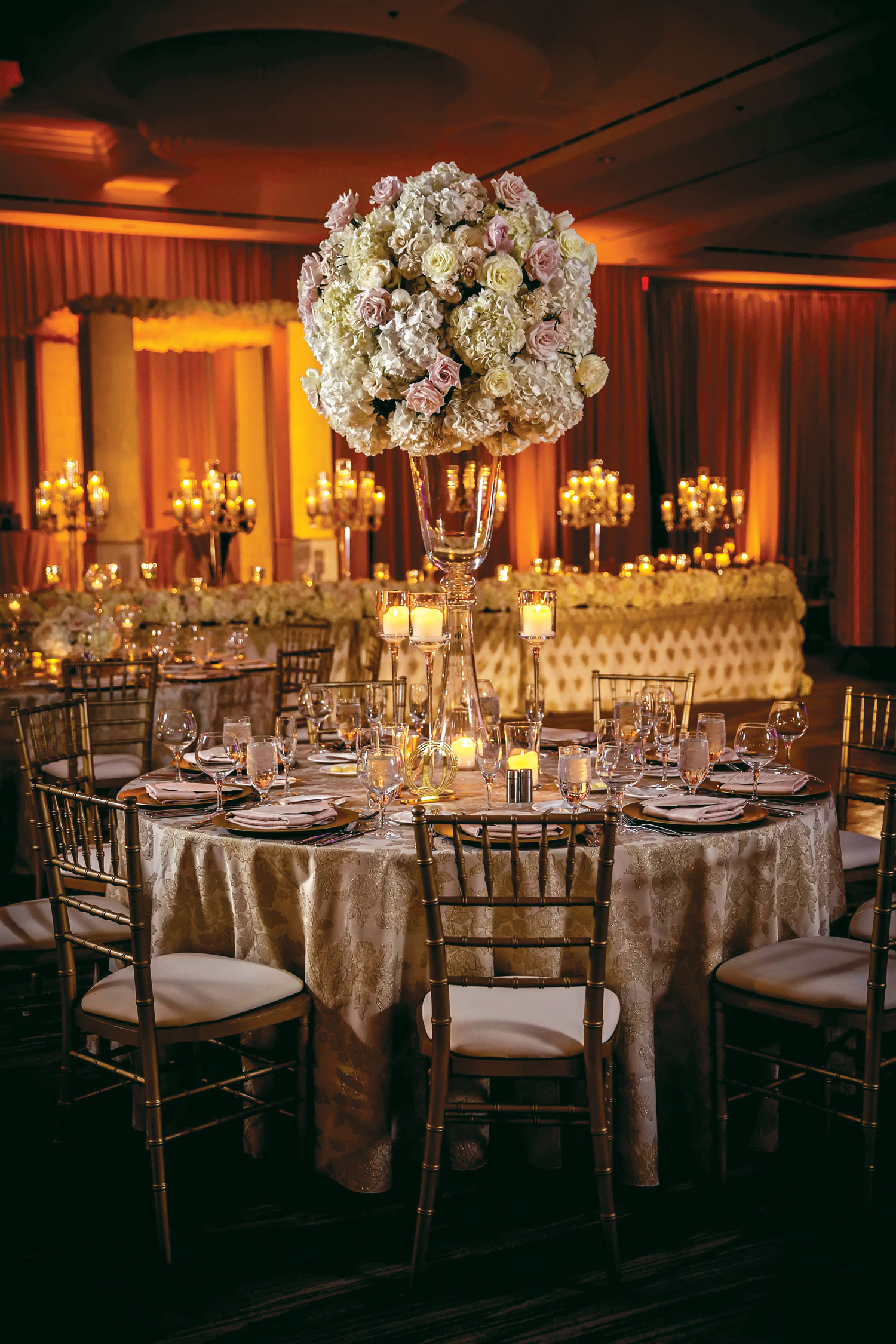 Inside Weddings magazine winter 2020 issue preview tall wedding reception centerpiece in ballroom