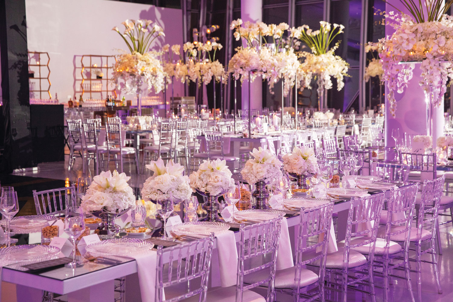 Inside Weddings magazine winter 2020 issue preview glam wedding reception purple pink lighting long table white flowers