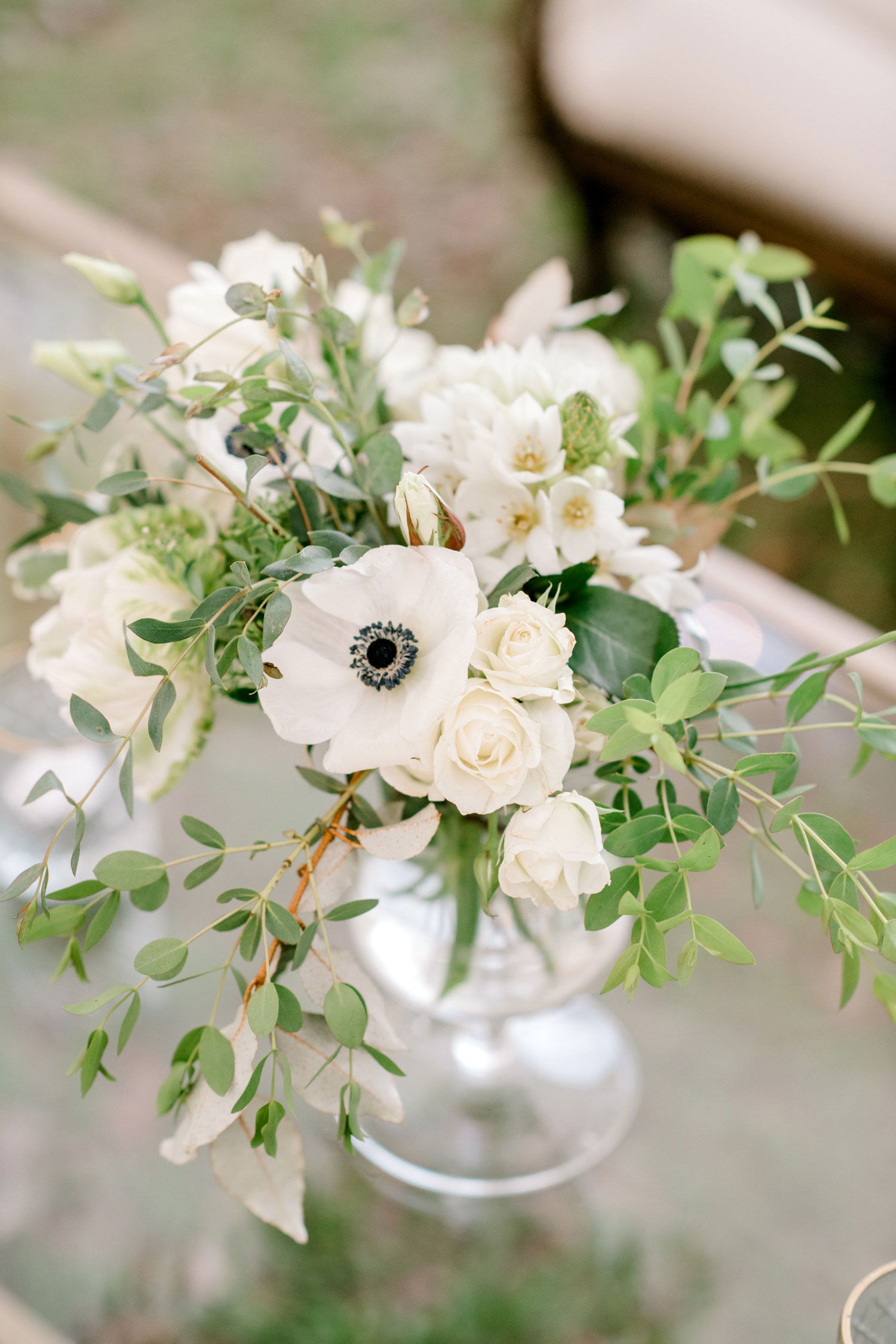 wedding reception lounge area centerpiece anemone flowers and greenery