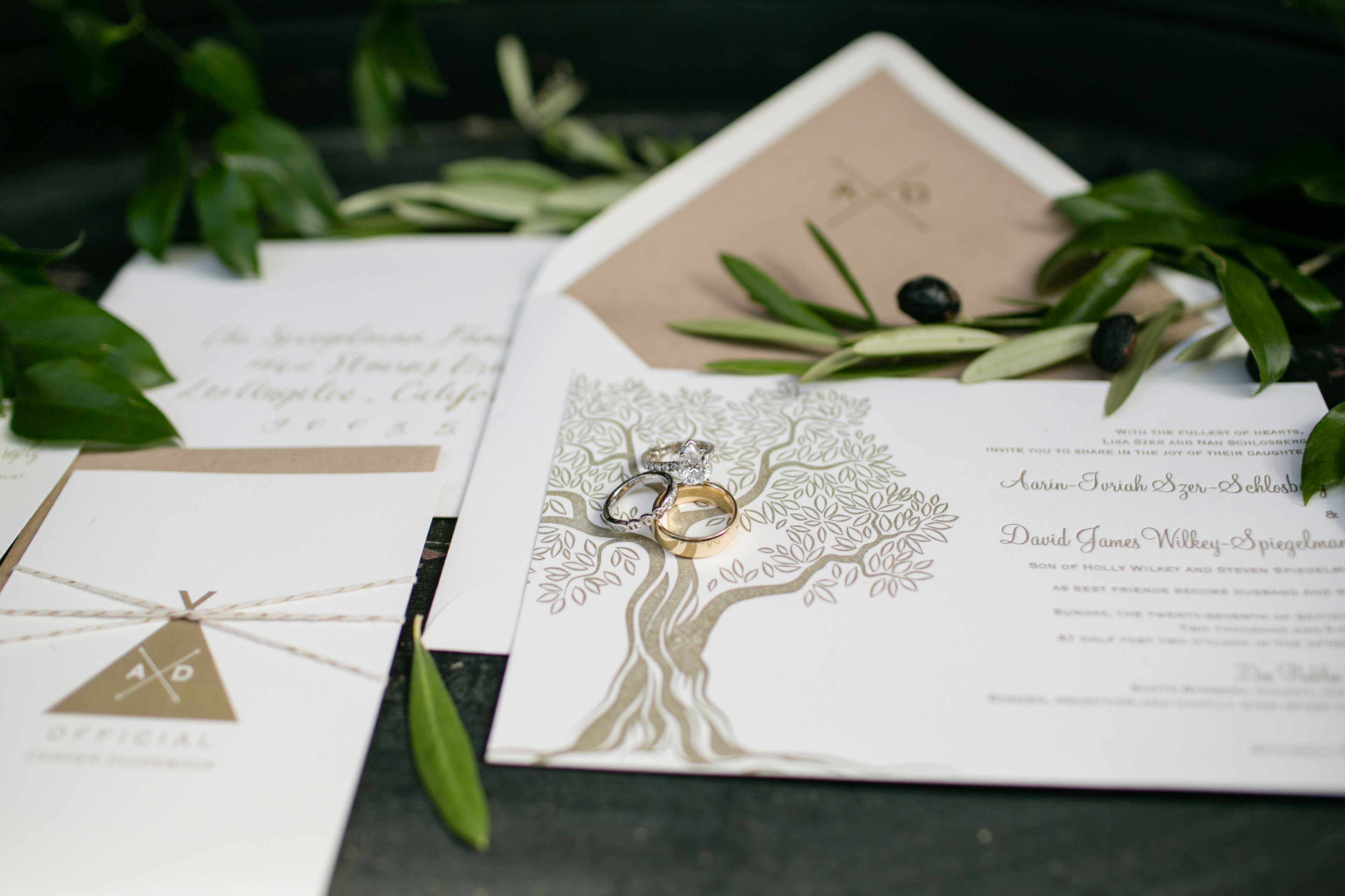 wedding invitation with gold envelope and tree motif design