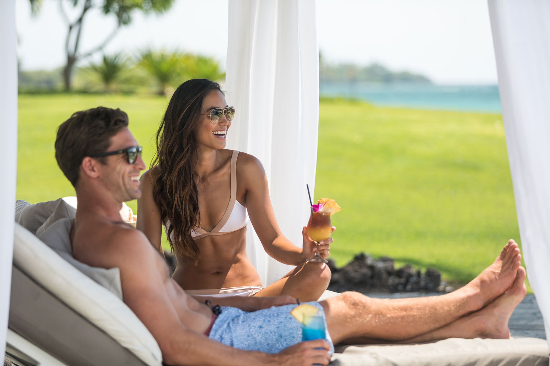 bride and groom on honeymoon cabana at waikoloa beach marriott big island hawaii wedding ideas