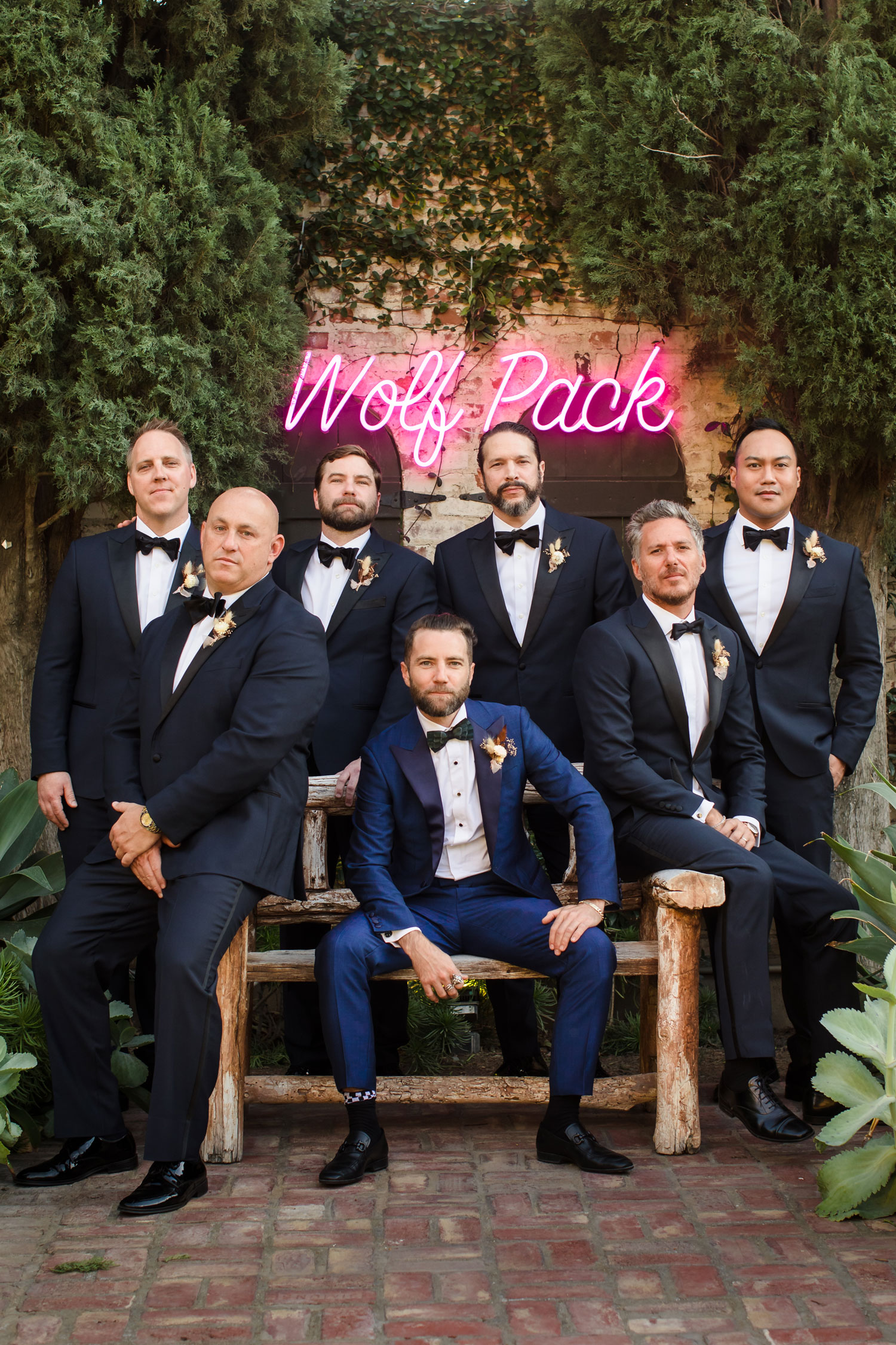 Top Chef Marcel Vigneron and Lauren Rae Levy real wedding planned by Tessa Lyn Events groom and groomsmen neon sign wolf pack
