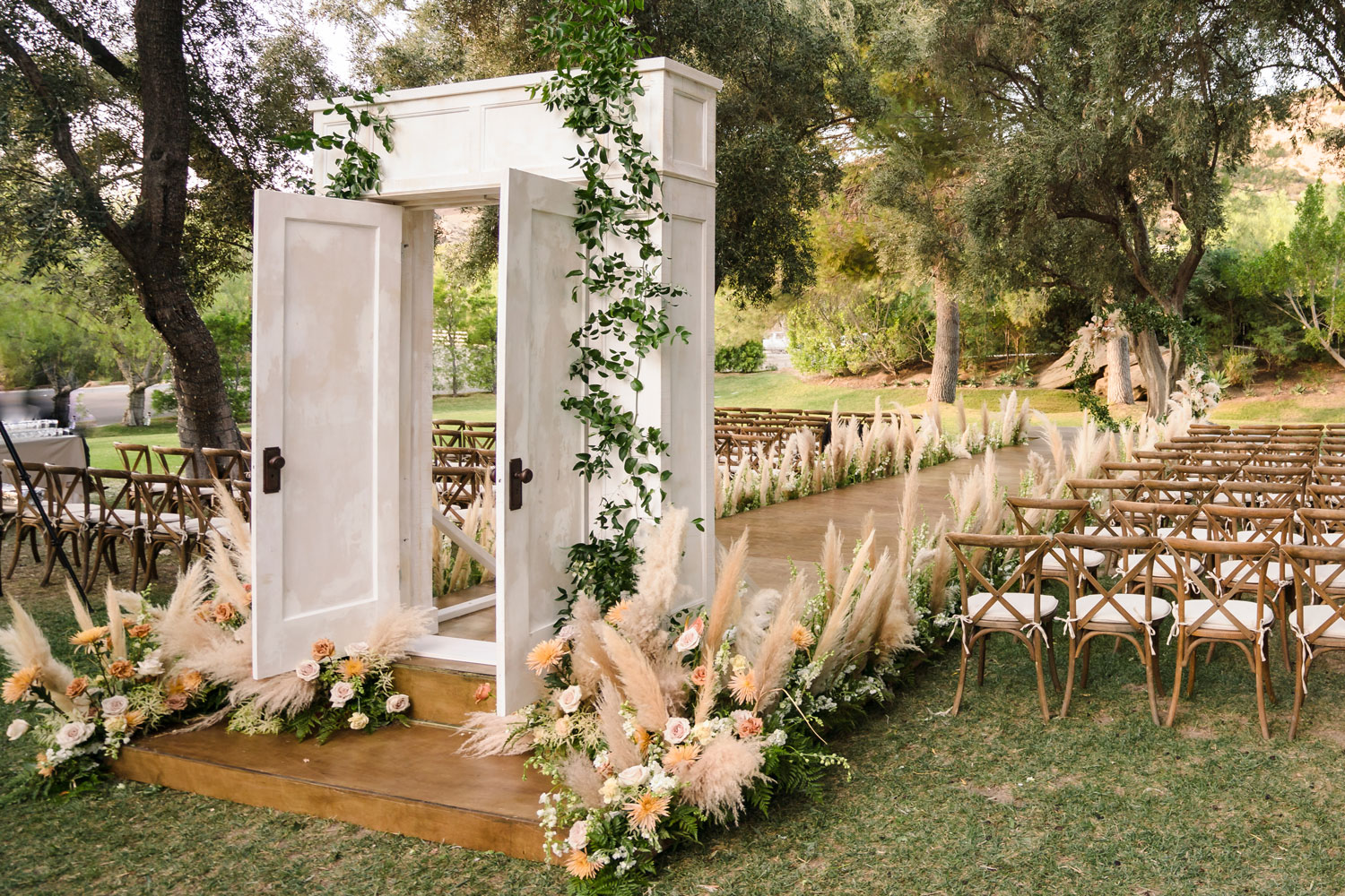 Top Chef Marcel Vigneron and Lauren Rae Levy real wedding planned by Tessa Lyn Events outdoor ceremony with doors to aisle