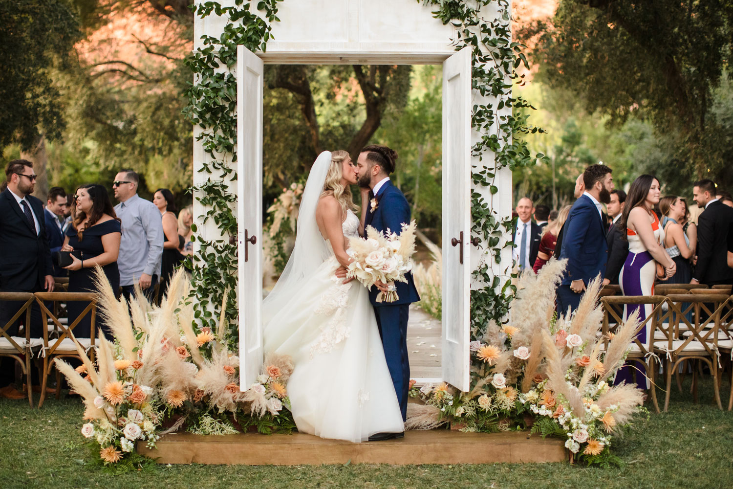 Top Chef Marcel Vigneron and Lauren Rae Levy real wedding planned by Tessa Lyn Events bride and groom kiss doorway to aisle