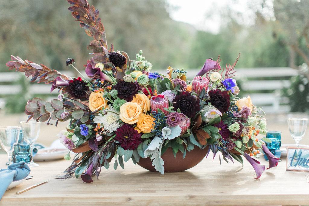 wedding reception centerpiece with winter colors blue purple protea flower ideas
