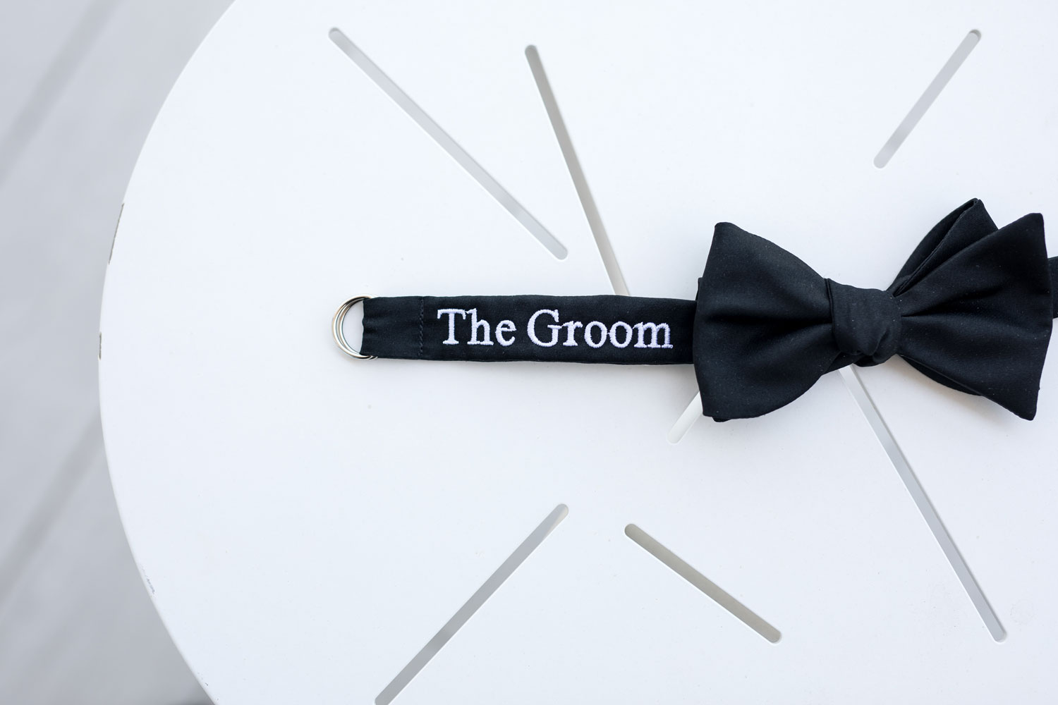 wedding detail shot groom's bow tie embroidery personalized