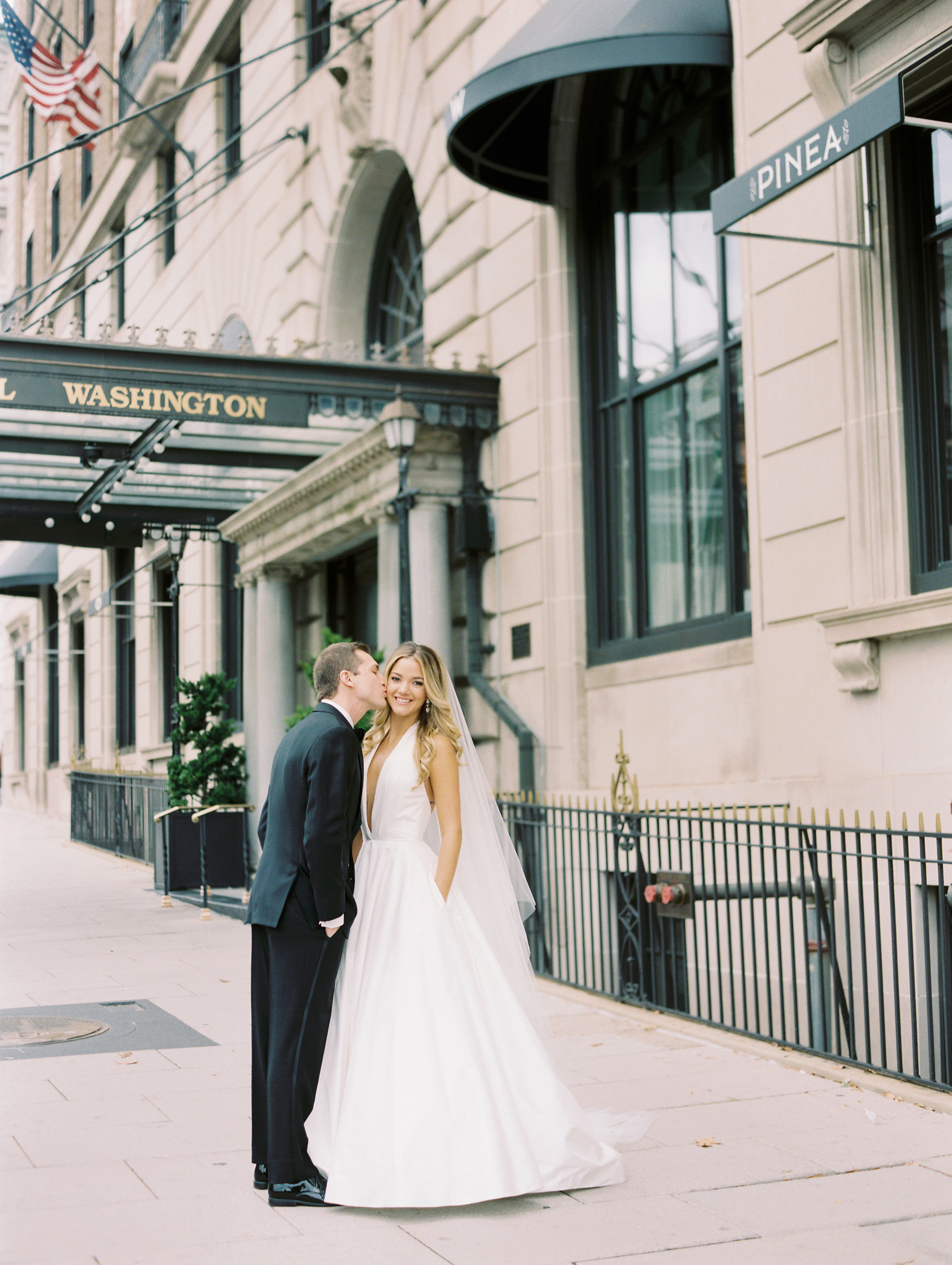 bride and groom in washington dc plunging neckline wedding dress with pockets
